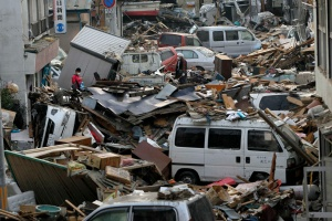 Debris is strewn over an area affected by an earthquake and tsunami in Miyako, Iwate Prefecture